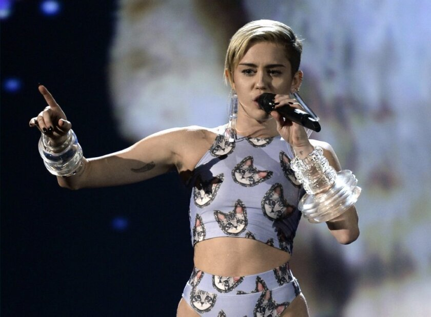 """Miley Cyrus, cat lover? The young star gave """"Wrecking Ball"""" a feline-friendly makeover."""