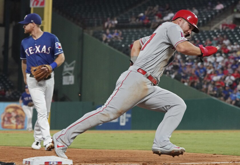 Angels' Mike Trout rounds third base as he heads home to score during the sixth inning against the Texas Rangers on Wednesday in Arlington, Texas.