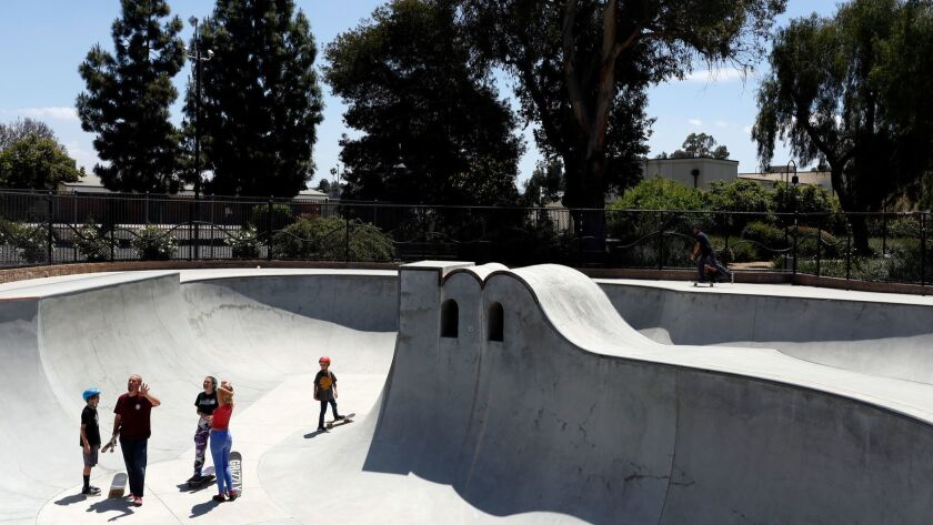 "VENTURA, CA-MAY 5, 2019: Skateboarders talk near a vert pillar in the shape of an ""M"" for Moorpark,"