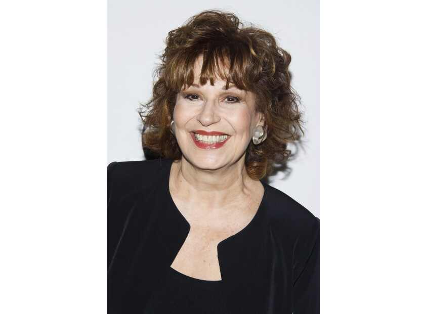"""FILE - This May 14, 2014 file photo shows Joy Behar in New York. Behar says she's going to skip her co-hosting duties on """"The View"""" next week and stay home amid growing concerns over the coronavirus. For most people, the new coronavirus causes only mild or moderate symptoms. For some it can cause more severe illness. (Photo by Charles Sykes/Invision/AP, File)"""