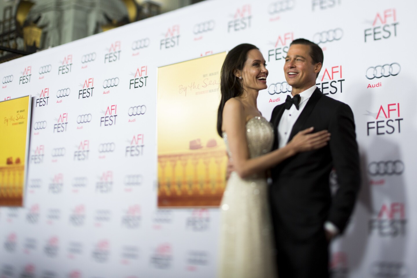"""Angelina Jolie Pitt and Brad Pitt pose on the red carpet for the opening night premiere of their film """"By the Sea"""" in Hollywood in November 2015."""