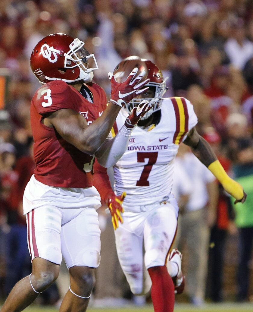 Oklahoma wide receiver Sterling Shepard (3) catches a pass ahead of Iowa State defensive end Seth Nerness (7) during the fourth quarter of an NCAA college football game in Norman, Okla., on Saturday, Nov. 7, 2015. Oklahoma won 52-16. (AP Photo/Alonzo Adams)