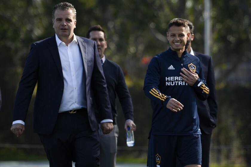 """Galaxy's Javier """"Chicharito"""" Hernández walks to the practice field with general manager Dennis te Kloese."""