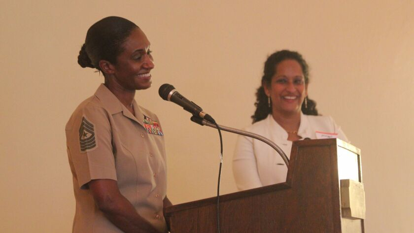 U.S. Marine Corps Sgt. Major Jennifer Simmons (left) answers audience questions, moderated by La Jol