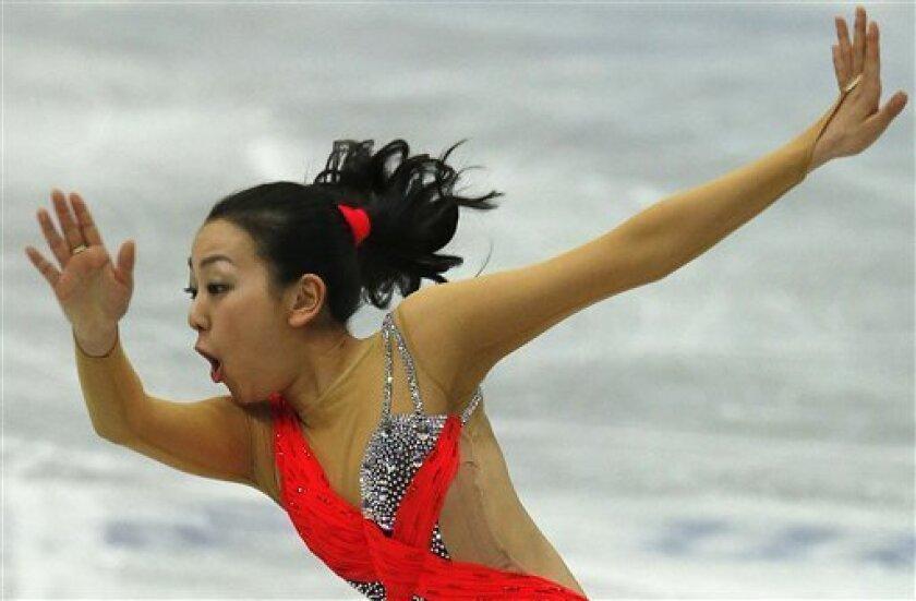 Mao Asada of Japan performs during the women short program event at the ISU Four Continents Figure Skating Championships in Osaka, western Japan, Saturday, Feb. 9, 2013. (AP Photo/Shizuo Kambayashi)