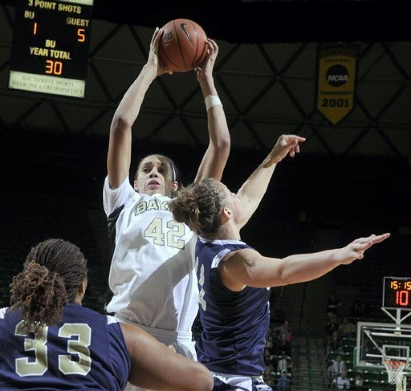 Baylor's Brittney Griner (42) pulls down a rebound over Oral Roberts Janae Voelker (11), right and Alex Adekunle (33) in the second half of a NCAA  college basketball game Wednesday Dec. 16, 2009 in Waco Texas. Baylor defeated Oral Roberts 101-76  (AP Photo/Rod Aydelotte)