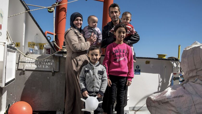 Suobhe Altmmo, 35, from Aleppo, with his family on board the rescue ship Aquarius.