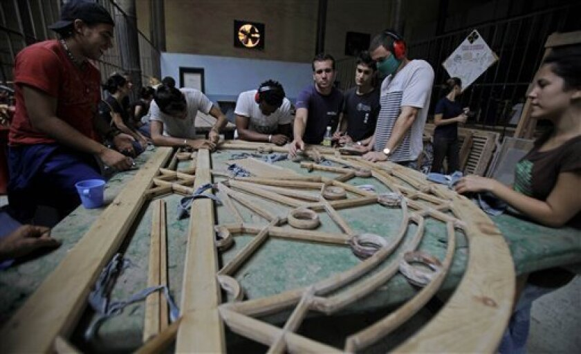 Students work to restore a stained glass window at the Gaspar Melchor de Jovellanos Workshop School in the historic district of Havana, Cuba, Tuesday May 31, 2011. Since its founding in 1992, the artistically inclined 17- to 25-year-olds who like working with their hands learn the rare art of historical restoration. The two-year course includes practical lessons in everything from carpentry and masonry to mural painting and plaster work. (AP Photo/Javier Galeano)