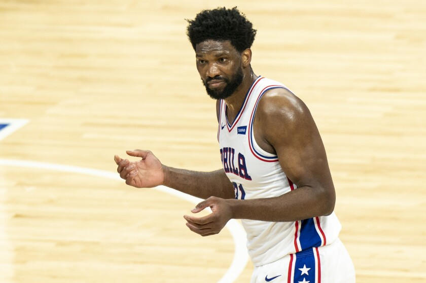 Philadelphia 76ers' Joel Embiid reacts to no call on a shot at the end of the first half of the team's NBA basketball game against the Minnesota Timberwolves, Saturday, April 3, 2021, in Philadelphia. (AP Photo/Chris Szagola)