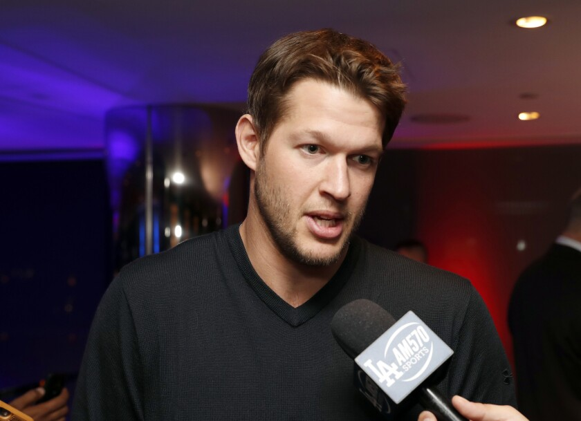 Dodgers pitcher Clayton Kershaw talks with reporters during an announcement event at the winter meetings on Dec. 5.