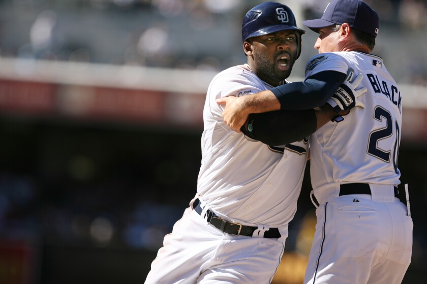 Padres manager Bud Black tries to restrain Milton Bradley during argument with umpire in 2007.