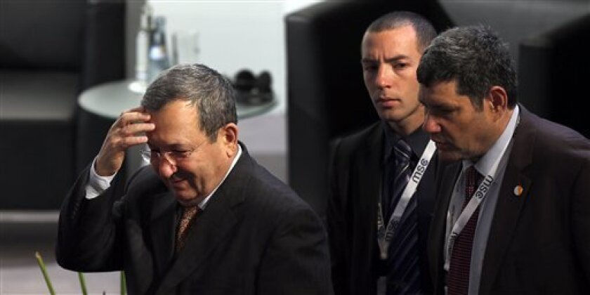 Ehud Barak, Defence Minister of Israel, left, arrivesat the International Security Conference in Munich, southern Germany, Saturday, Feb. 2, 2013. The  Munich Security Conference started Friday afternoon with experts from 90 delegations including U.S. Vice President Joe Biden. (AP Photo/Matthias Sc