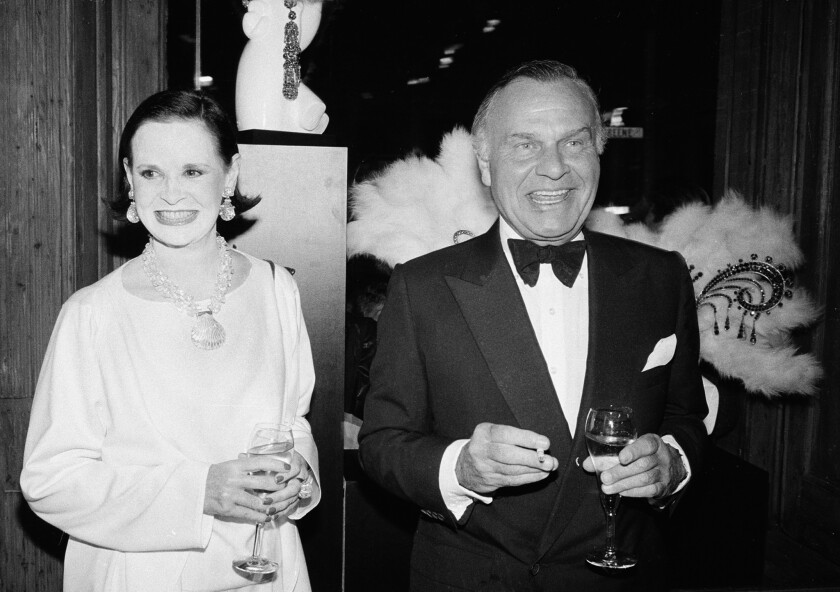 FILE - In this Nov. 9, 1982 file photo, fashion designers Gloria Vanderbilt, left, and Bill Blass ar