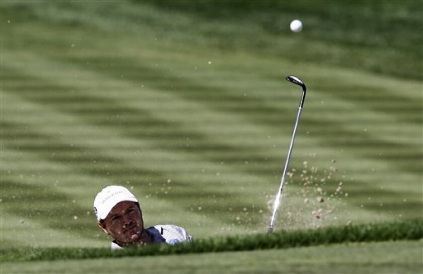 Richard Sterne from South Africa plays a ball on the 3rd hole during final round of the Dubai Desert Classic Golf tournament in Dubai, United Arab Emirates, Sunday, Feb. 3, 2013. (AP Photo/Kamran Jebreili)