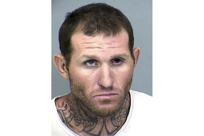 This Maricopa County Sheriff's Office booking photo shows former state prison inmate fugitive, Clinton Hurley. On Saturday, Oct. 9, 2021, Hurley attacked a sheriff's deputy while being processed for felony warrants. Hurley fled the scene in the sheriff's Tahoe vehicle after the assault in Phoenix. He later abandoned the Tahoe and carjacked another unknown vehicle. Hurley has a history of violence. He has two outstanding warrants and is considered armed and dangerous. (Maricopa County Sheriff's Office via AP)