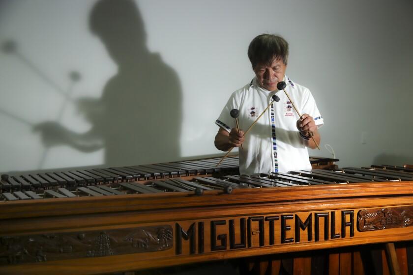 Rosauro Esteban, a Guatemalan musician, restores an old marimba