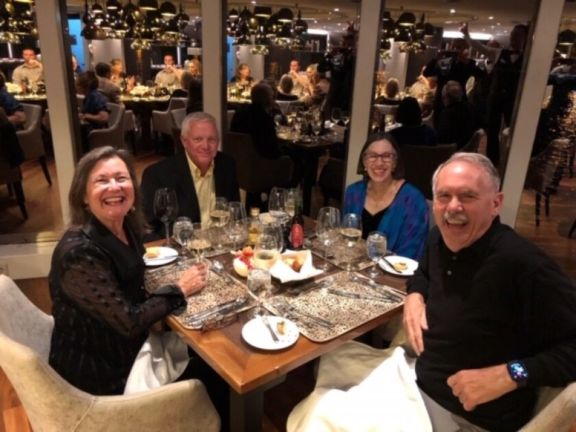 Jim and Carol Williams with friends and fellow members Paul and Dottie Pakus at dinner on a wine club river cruise.