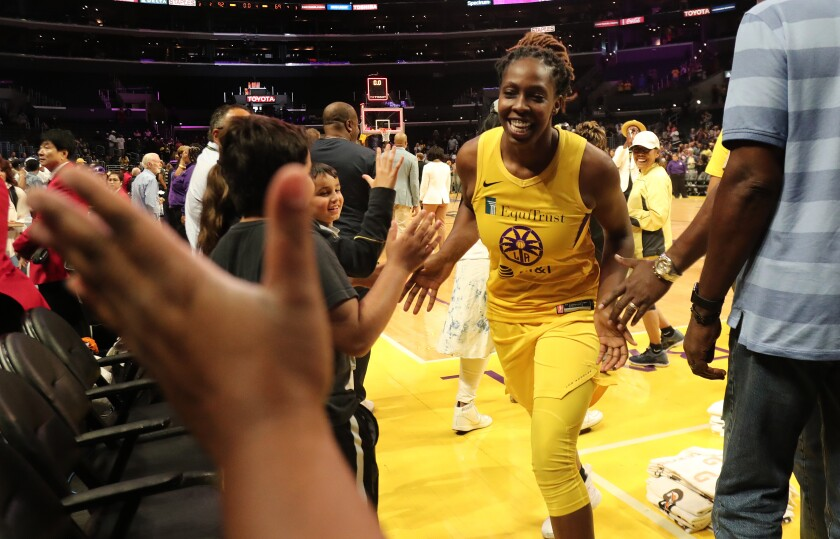 Sparks guard Chelsea Gray is congratulated s after a 92-69 victory over the Seattle Storm in a playoff game on Sept. 15, 2019, at Staples Center.