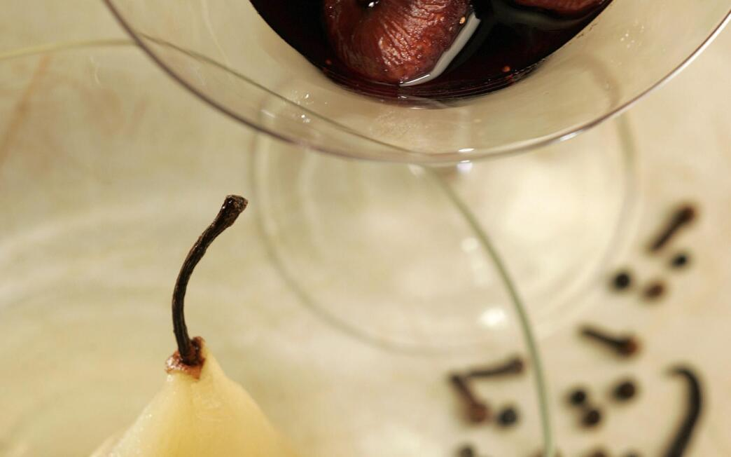 Poached pears with poached, spiced figs