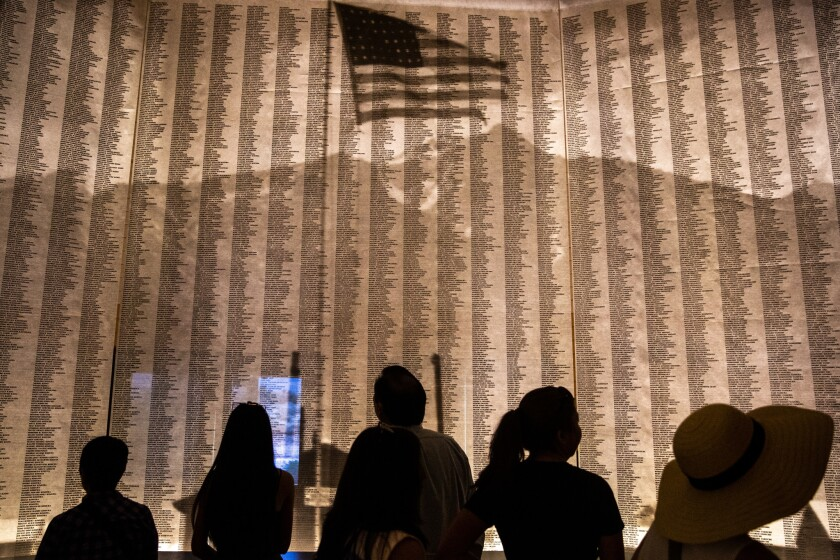INDEPENDENCE, CALIF. - APRIL 27: People look at a display of all the names of people, who forced to
