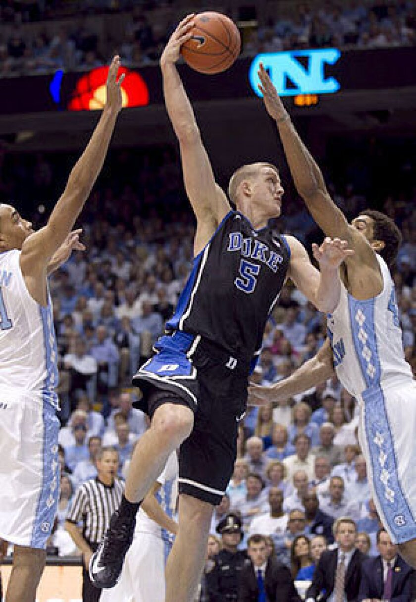 Duke's Mason Plumlee (5) puts up a hook shot over North Carolina's James Michael McAdoo in the second half at the Smith Center in Chapel Hill, N.C. Duke topped the Tar Heels, 69-53.