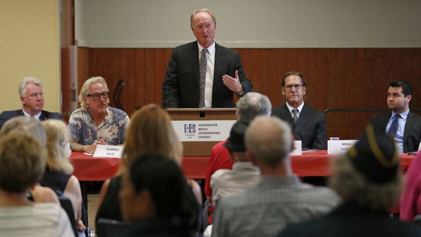 Mayor Michael Posey speaks during a candidate forum at Murdy Park Recreational Center in Huntington