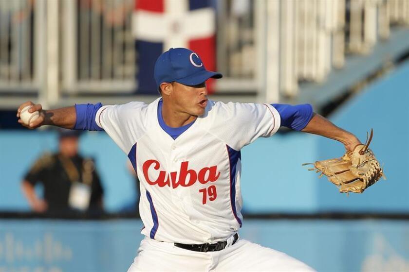 El zurdo dominicano Yohan Flande, quien jugó Grandes Ligas el año pasado con los Rockies de Colorado, enfrentará mañana al derecho cubano Lázaro Blanco, en el juego inaugural de la Serie del Caribe de Béisbol. EFE/ARCHIVO