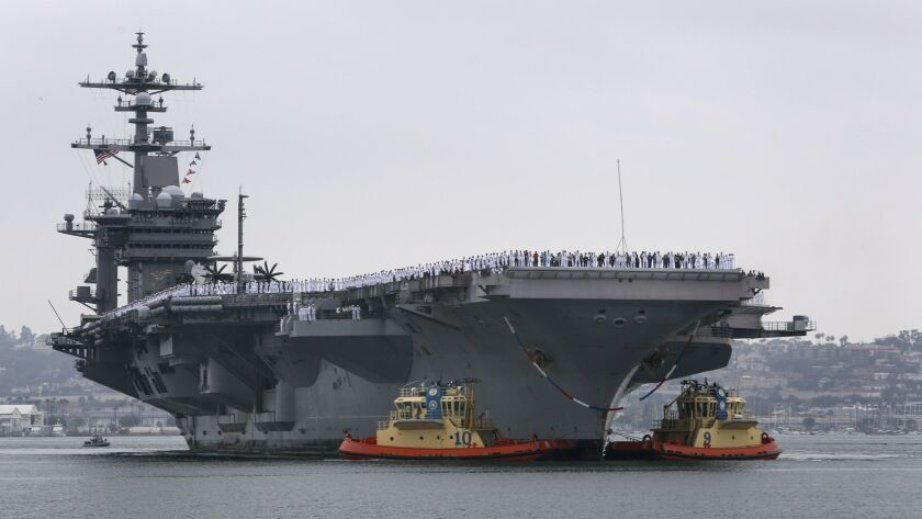 The aircraft carrier, USS Carl Vinson, arrives at Naval Air Station North Island in 2017.