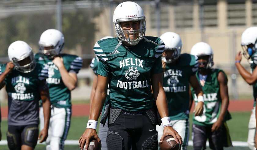 Helix quarterback Carson Baker is working to get the offense in gear.