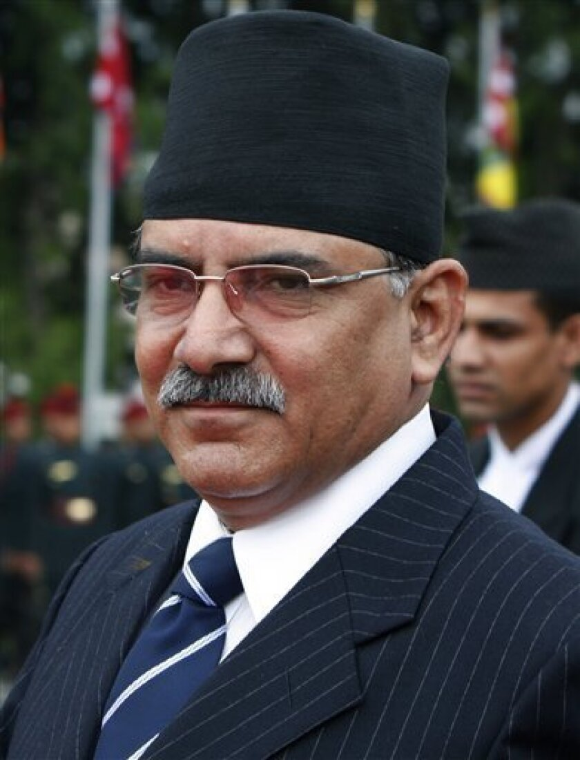FILE - In this Sept. 20, 2008 file photo Nepal's Prime Minister Pushpa Kamal Dahal leaves for a visit to United States, in Katmandu, Nepal. Dahal announced his resignation on Monday on national television following confrontation with the president over sacking of the nation's army chief. (AP Photo/Binod Joshi, file)