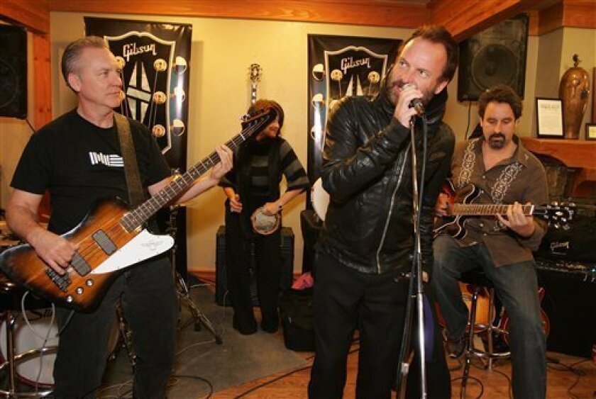 In this photo provided by Gibson Guitar, musician Sting, center, performs with the Gibson Guitar Band at the Gibson Guitar Lounge during the Sundance Film Festival in Park City, Utah, on Sunday, Jan. 18, 2009. (AP Photo/Gibson Guitar, Marsaili McGrath)