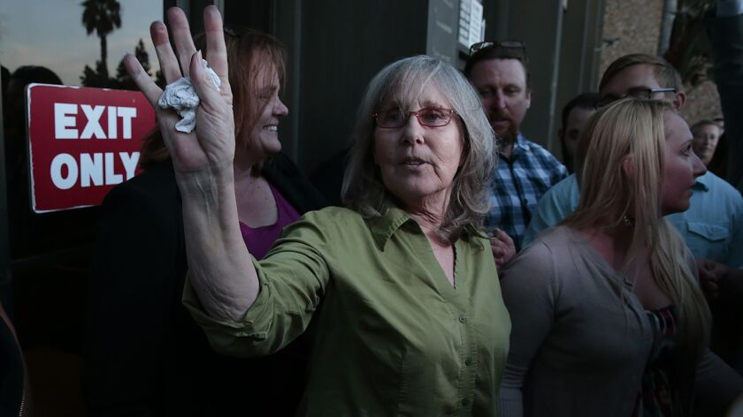 TORRANCE, CA, FRIDAY, OCTOBER 10, 2014 - Susan Mellen, 59, is greeted by family, friends and media o