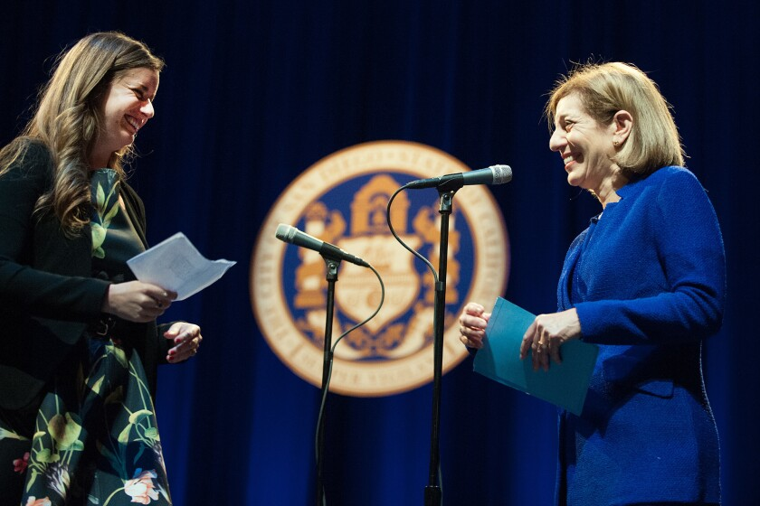 San Diego City District 1 Councilmember Barbara Bry (right) is sworn into office by daughter Rachel Kruer.