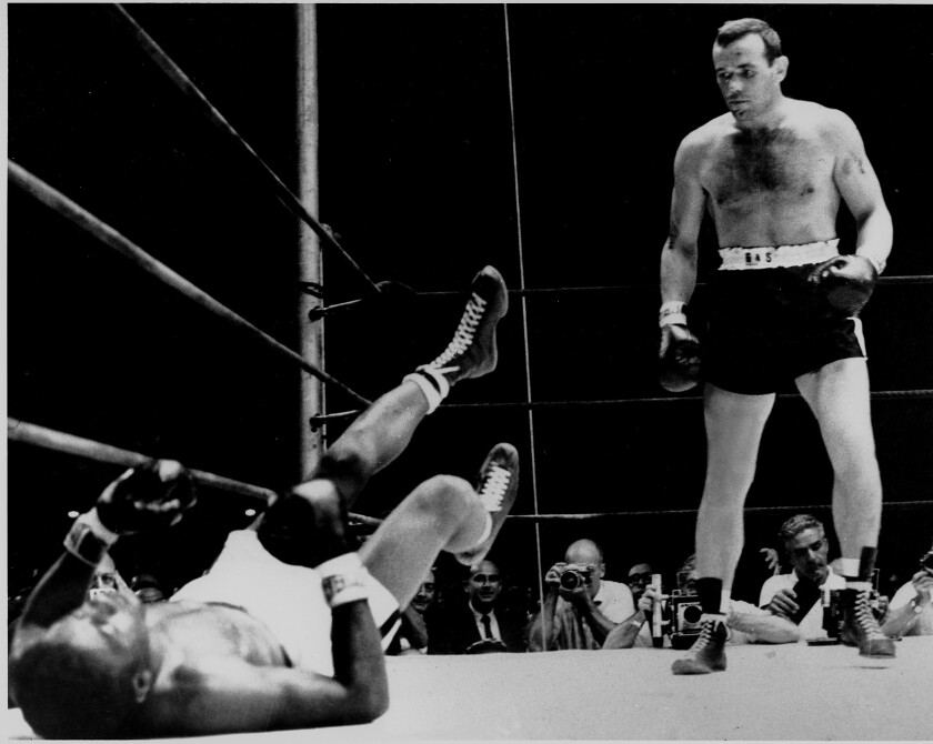 Floyd Patterson lies on the canvas after taking a knockout blow from Ingemar Johansson.