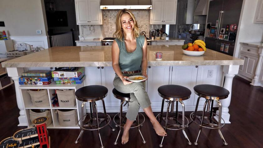"Marissa Hermer's London kitchen was tiny, but the one in her Pacific Palisades home is big enough so that ""we can all do cartwheels ... and not hit each other,"" she says."
