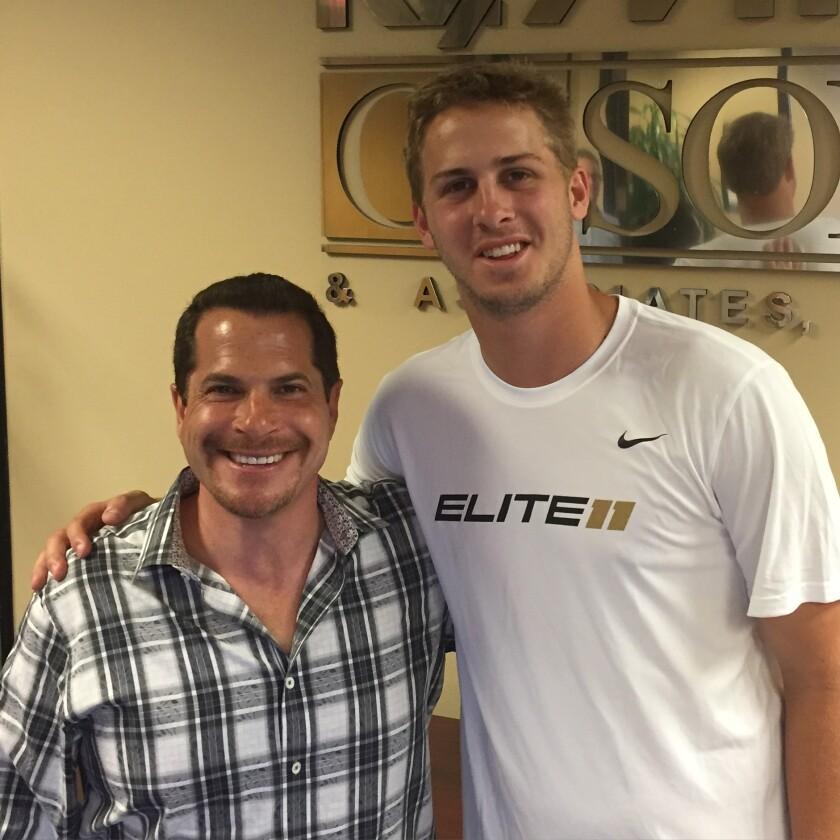 Jordan Cohen, left, with L.A. Rams quarterback Jared Goff