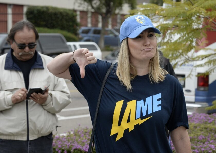 Bre Priest gives the thumbs down while wearing a t-shirt mocking the team at San Diego Chargers head
