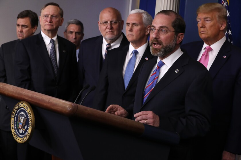 "Alex Azar, secretary of Health and Human Services, right, with public health officials in the White House briefing room Feb. 26, said, ""We can expect to see more cases in the United States."""