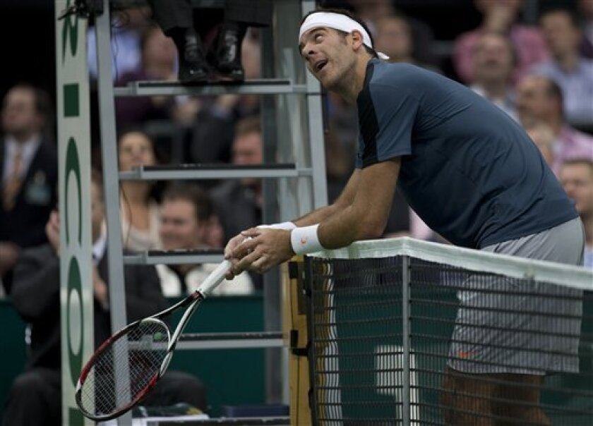 Juan Martin del Potro of Argentina watches images of the Hawk-Eye electronic line-calling system after Gael Monfils of France challenged a line call at the ABN AMRO world tennis tournament at Ahoy Arena in Rotterdam, Netherlands, Tuesday Feb. 12, 2013. Del Potro won in two sets, 6-3, 6-4. (AP Photo