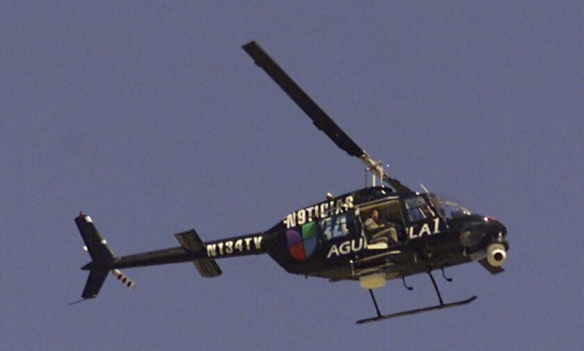 A news helicopter over Canoga Park