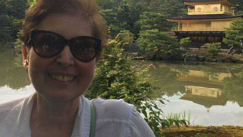Tenny Tatusian smiles outside the Temple of the Golden Pavilion in Kyoto, Japan.