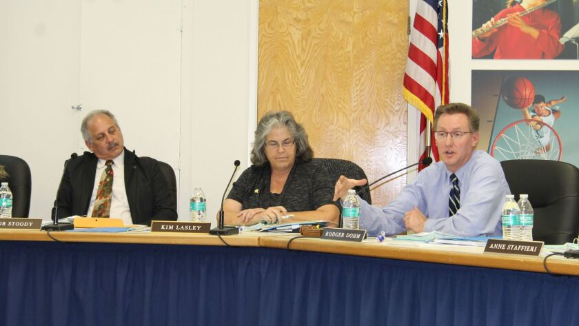 Ramona Unified trustees Bob Stoody and Kim Lasley listen as board member Rodger Dohm talks during a recent school board meeting.
