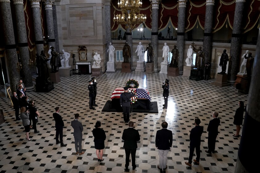 Capitol Hill staffers pay their respects as the late Justice Ruth Bader Ginsburg lies in state.