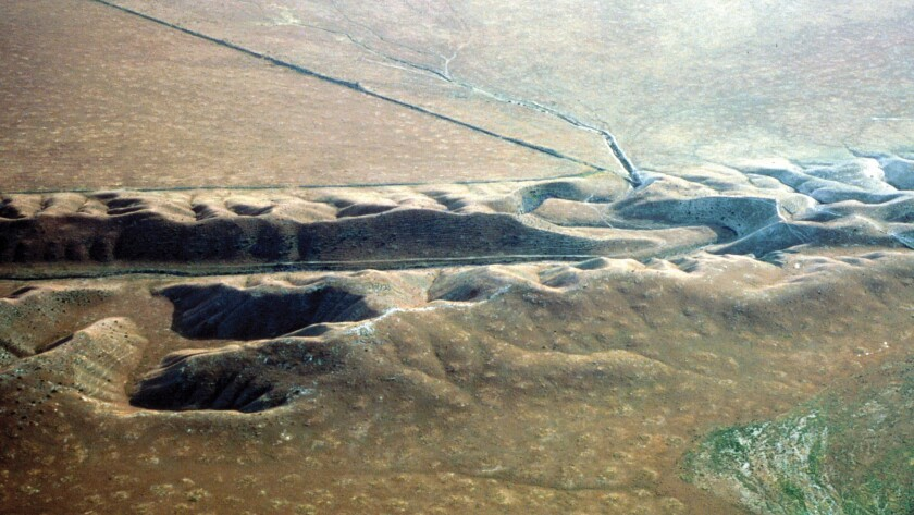 A view of the San Andreas fault in the Carrizo Plain. A valley is deeply eroded along the fault.