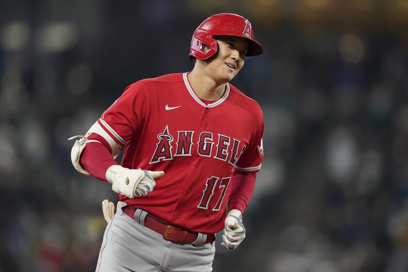 Los Angeles Angels' Shohei Ohtani rounds the bases after he hit a solo home run during the first inning of a baseball game against the Seattle Mariners, Sunday, Oct. 3, 2021, in Seattle. (AP Photo/Ted S. Warren)