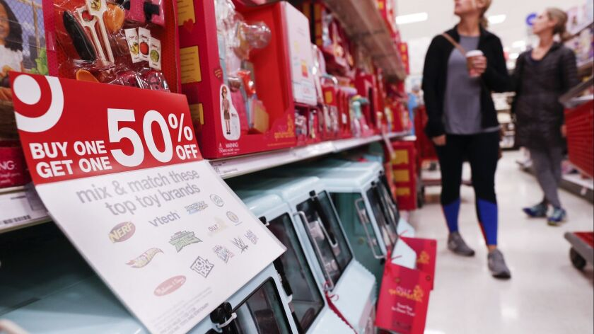 Shoppers browse the aisles during a Black Friday sale at a Target store