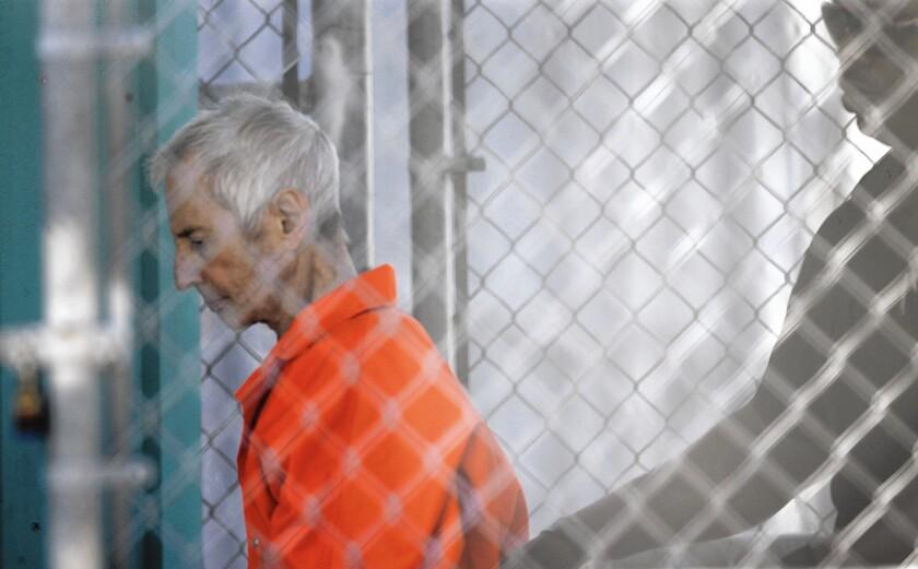 Robert Durst is escorted into Orleans Parish Prison after his arraignment in Orleans Parish Criminal District Court in New Orleans.
