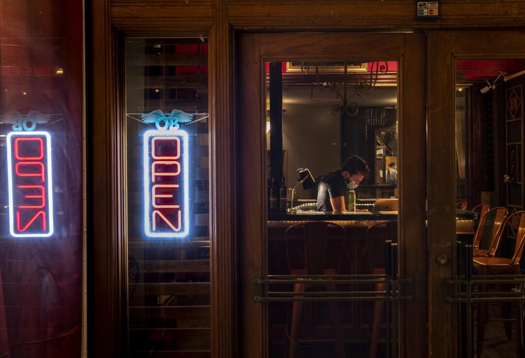Tasting room associate Dakota Croog waits for customers at Passion Cellars, a wine tasting bar in Bisbee.