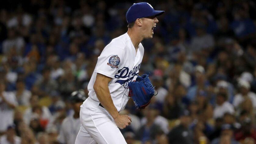 LOS ANGELES, CALIF. - SEP. 19, 2018. Dodgers pitcher Walker BUehler celebrates after getting his