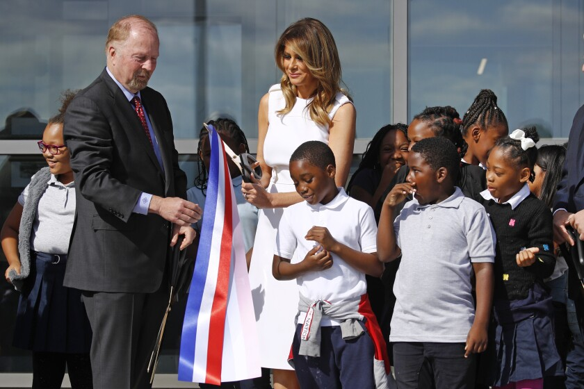 First lady Melania Trump, center, and Department of Interior assistant secretary Rob Wallace, left, participate in a ribbon-cutting ceremony with students from Amidon-Bowen Elementary School in Washington to re-open the Washington Monument, Thursday, Sept. 19, 2019, in Washington. The monument has been closed to the public for renovations since August 2016. (AP Photo/Patrick Semansky)